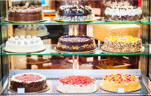 Pastry shop in glass cabinet display